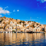 Symi, the harbor by Guy Fattal